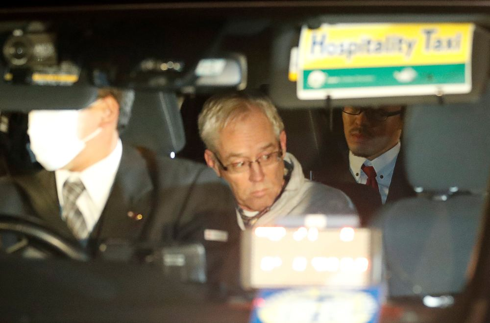 Greg Kelly, the former deputy of ousted Nissan chairman Carlos Ghosn, is seen in the car, as he leaves after being released from a detention centre in Tokyo December 25, 2018. — Reuters pic