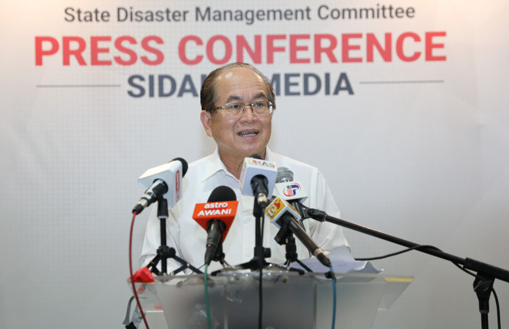 Datuk Amar Douglas Uggah Embas says the policy of full containment adopted by Sarawak Disaster Management Committee has been successful in flattening the Covid-19 curve in the state so far. — Picture courtesy of Sarawak Public Communications Unit (Ukas)