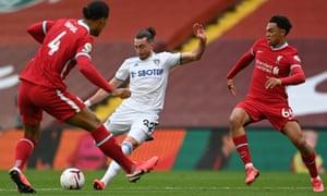 Leeds United's Jack Harrison fires a shot past Liverpool's Dutch defender Virgil van Dijk (left) and Trent Alexander-Arnold for their equaliser.