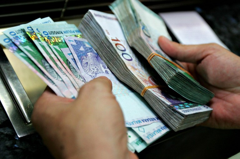 At 9am, the local unit stood at 4.1130/1170 versus the greenback from yesterday's close of 4.1105/1145. — AFP pic