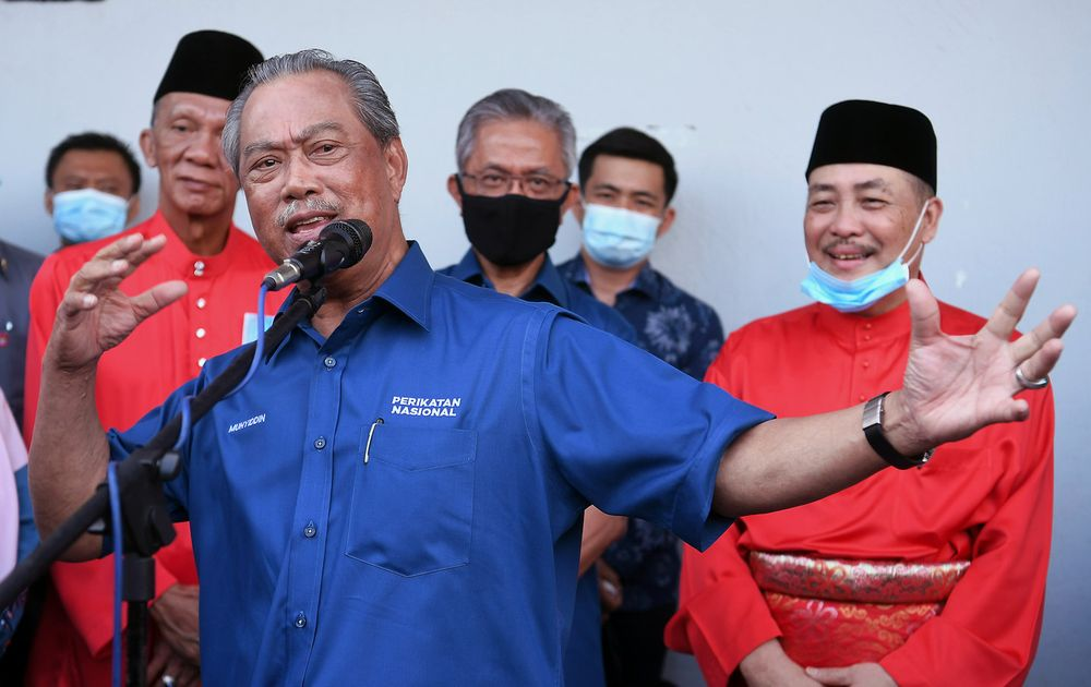 Prime Minister Tan Sri Muhyiddin Yassin delivering a speech in a gathering before the nomination process for the Sabah state election at Tuaran Parti Pribumi Bersatu Malaysia (Bersatu) office, September 12, 2020. Also present is Perikatan Nasional candidate for the Sulaman state seat Datuk Seri Hajiji Mohd Noor (right). — Bernama pic