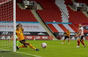 Conor Coady deflects Baldock's shot around the post.