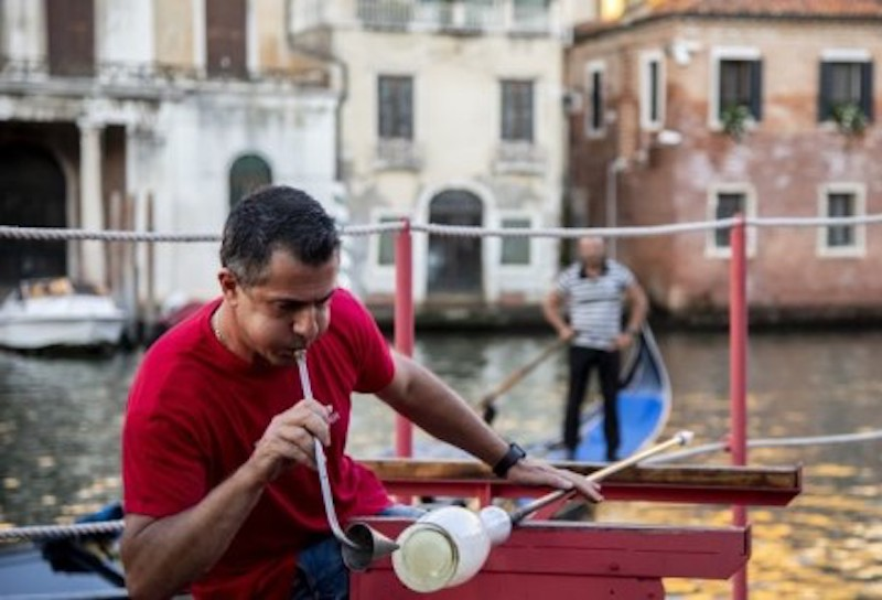 Italian glass master Matteo Tagliapietra dislays glass blowing and manufacturing techniques on 'The Floating Furnace' boat equiped with a kiln. — AFP-Relaxnews pic