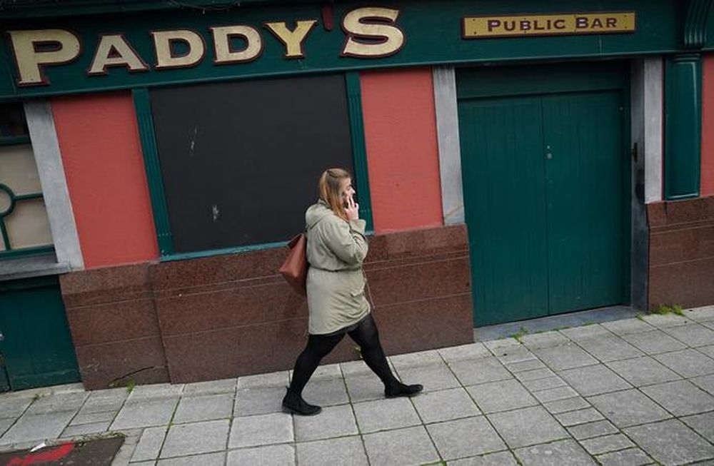 A woman walks past a shuttered pub called Paddy's which is closed due to government restrictions, amid the coronavirus disease (Covid-19) pandemic, in Galway, Ireland, September 9, 2020. — Reuters pic