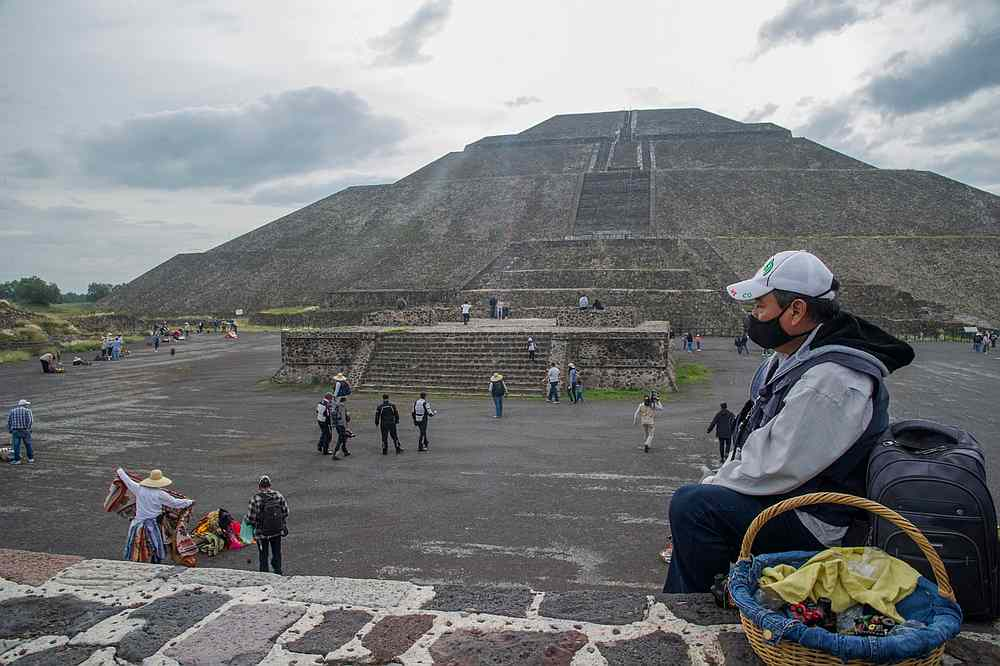 A handicraft vendor waits for tourist at the archaeological site of Teotihuacan, one of Mexico's top tourist attractions, during its reopening amid the Covid-19 pandemic. — AFP pic