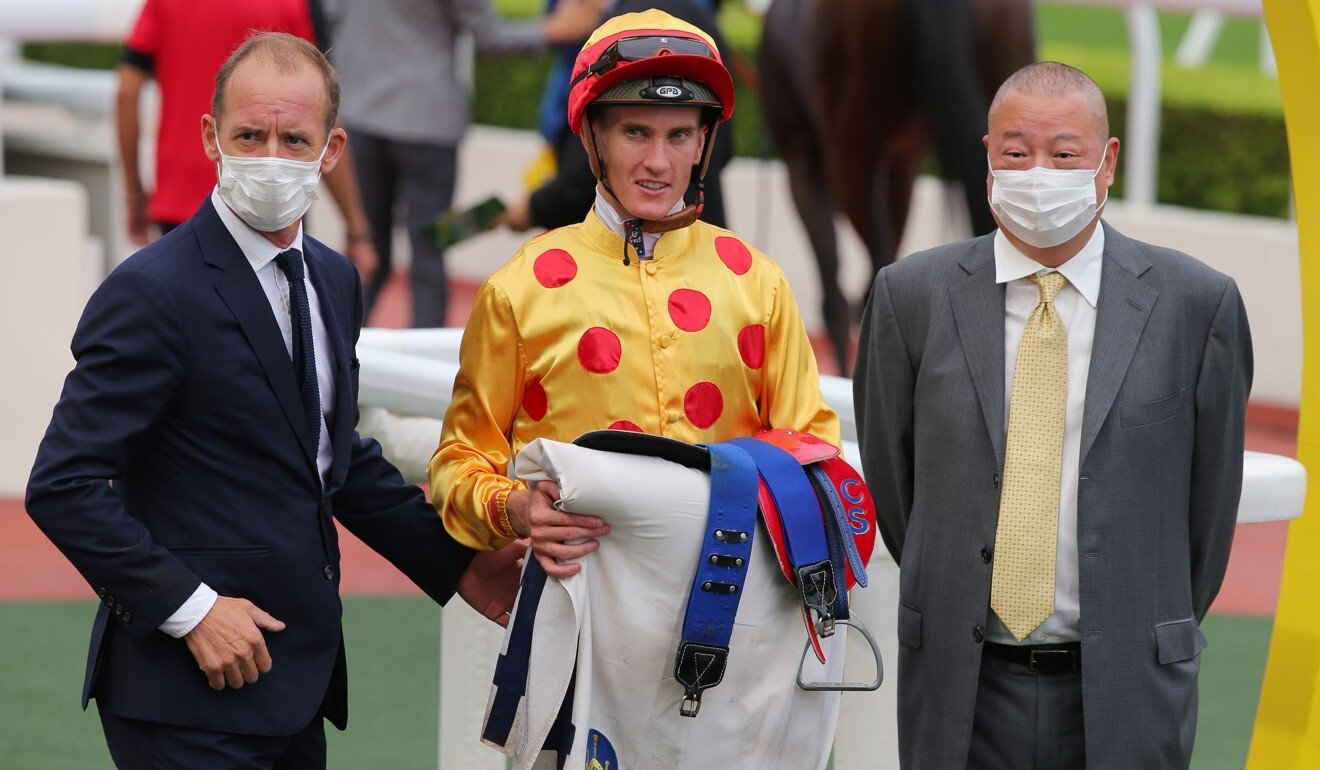 Trainer Richard Gibson (left), jockey Chad Schofield and Gold Chest's owner Pan Sutong.