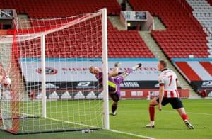 Sheffield United keeper Aaron Ramsdale is beaten by Raul Jimenez's volley.