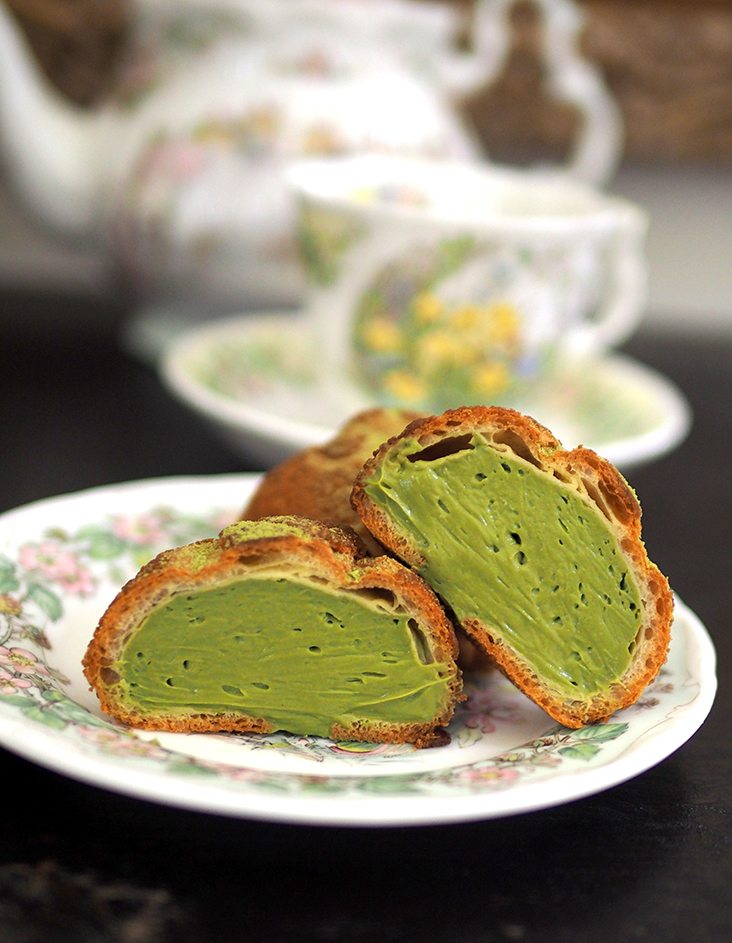 The choux buns are generously filled with matcha cream.