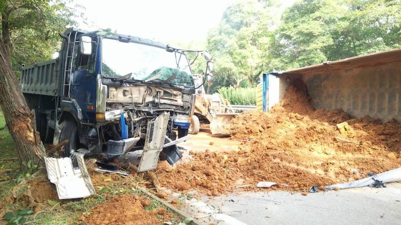 A sand truck had toppled over and covered the entire road. — Picture via Twitter/@aimadazfar.