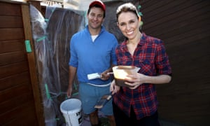 Labour party leader Jacinda Ardern (R) and her partner Clarke Gayford (L) pose for cameras on election day in 2017.