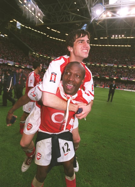 Lauren gives Cesc Fàbregas a lift after Arsenal win the 2005 FA Cup. Both were recommended by Francis Cagigao.