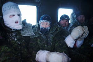 Canadian pilots and air crew seen after a week of Arctic survival training for military personal from Canada, the UK and France at the Canadian Forces Crystal City training facility near Resolute Bay in Nunavut, Canada. These military personnel are in a tracked ground vehicle taking them back to heated facilities after a week of living outdoors in makeshift shelters at temperatures below minus 50 degrees Celsius.