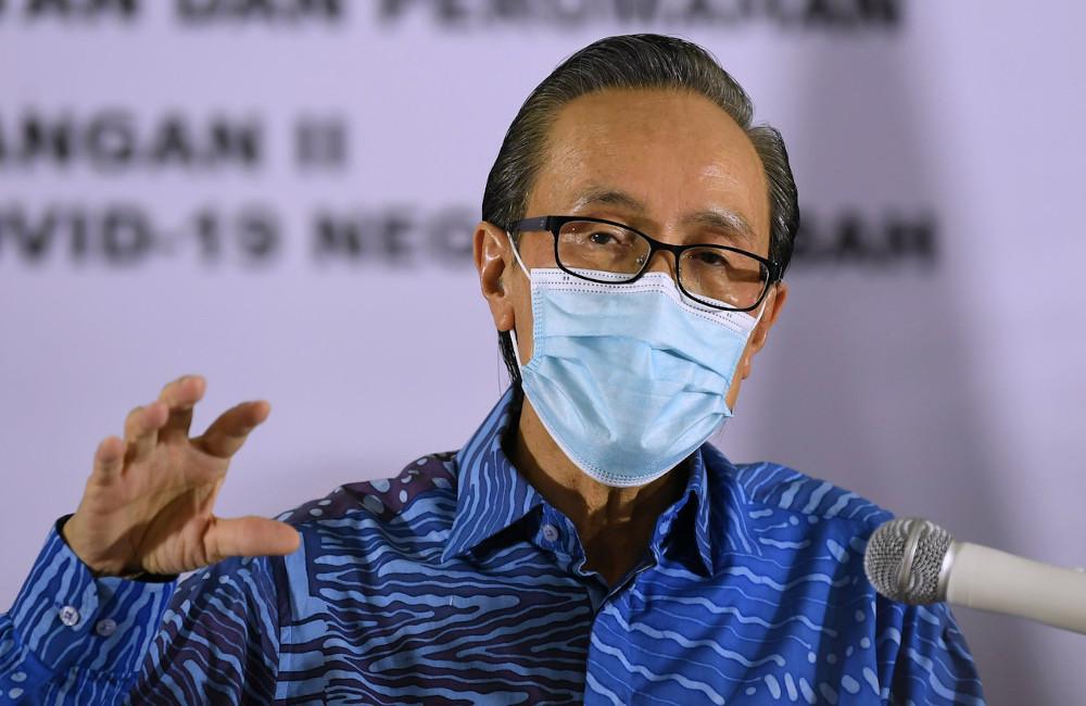 Sabah Local Government and Housing Minister Datuk Seri Masidi Manjun speaks to reporter in Kota Kinabalu October 18, 2020. — Bernama pic