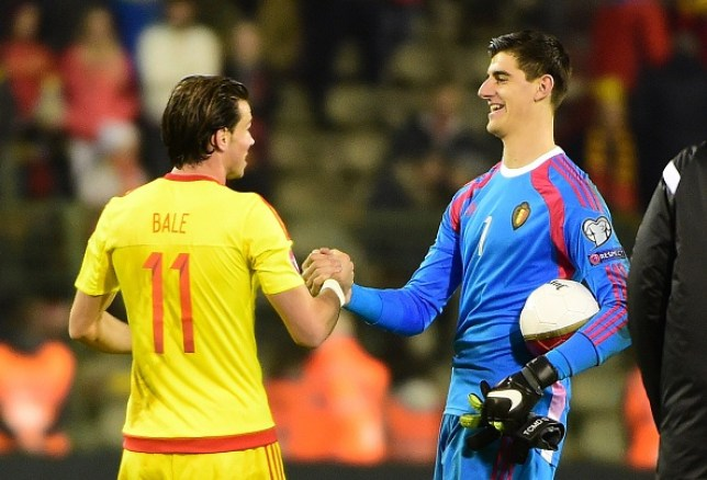 Belgium's goalkeeper Thibaut Courtois and Wales' Gareth Bale shake hands at the end of the Group B Euro 2016 qualifying match between Belgium and Wales at the King Baudouin stadium in Brussels, November 16, 2014.
