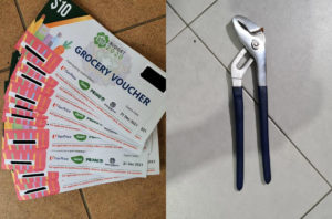Stacks of grocery vouchers, at left, and a pair of pliers seized from a suspect. Photos: Singapore Police Force