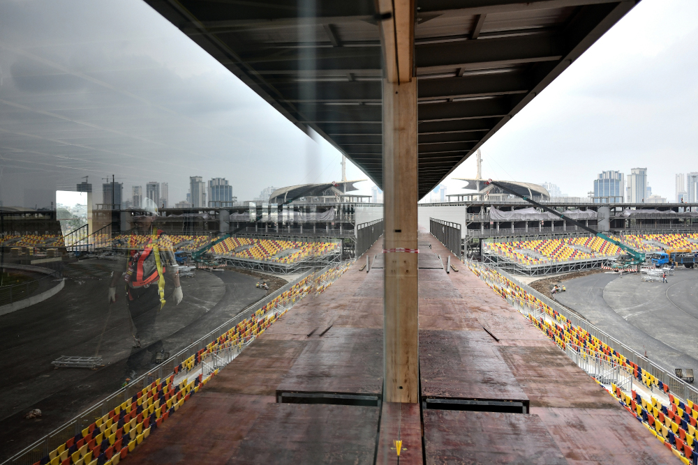 In this file photo taken February 14, 2020, a worker walks past the under-construction Formula One Vietnam Grand Prix race track site in Hanoi, amid concerns of the Covid-19 coronavirus outbreak. — AFP pic