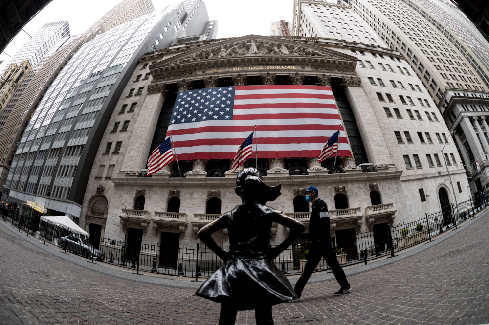 In this file photo the fearless girl statue and the New York Stock Exchange (NYSE) are pictured on April 20, 2020 at Wall Street in New York. — AFP pic