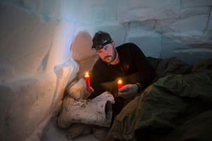 Canadian soldier Master Bombardier Jonathan Caron Corriveau holds survival candles that will be his only source of heat in an igloo he built on an Arctic Operations Advisors course. Soldiers learn from Inuit instructors how to build and sleep in improvised survival shelters at the Crystal City training area near Resolute Bay, where temperatures at times were as low as -50 degrees (-58 F) with the windchill.