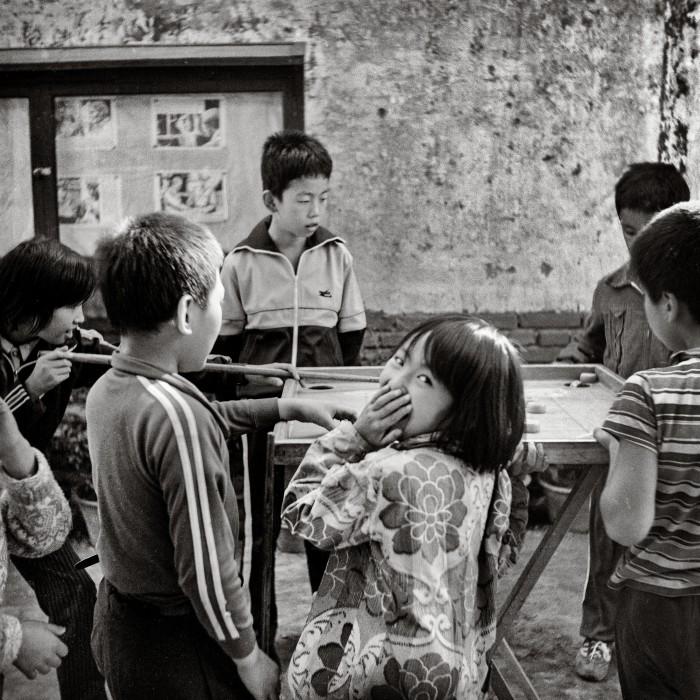 Billiard Girl – children play billiards in the street in Beijing