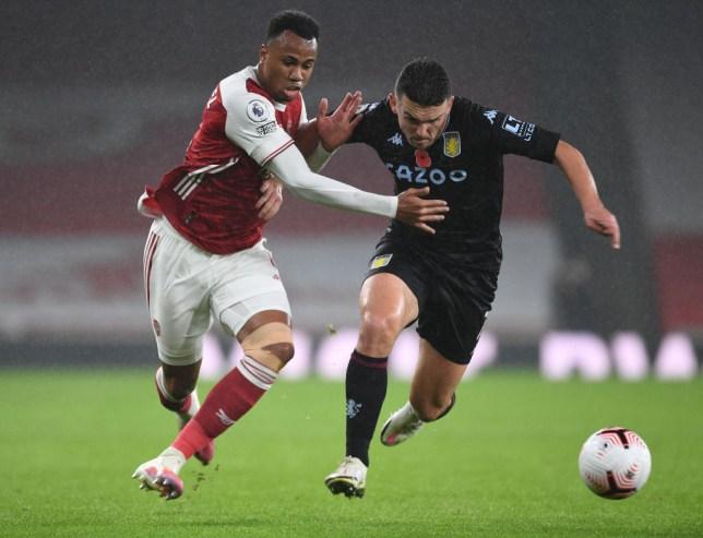 Gabriel battles John McGinn for the ball in Arsenal's defeat to Aston Villa in the Premier League