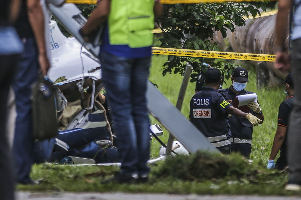 File photo showing forensic police at the site where a helicopter crashed in Taman Melawati, Kuala Lumpur November 8, 2020. — Picture by Hari Anggara