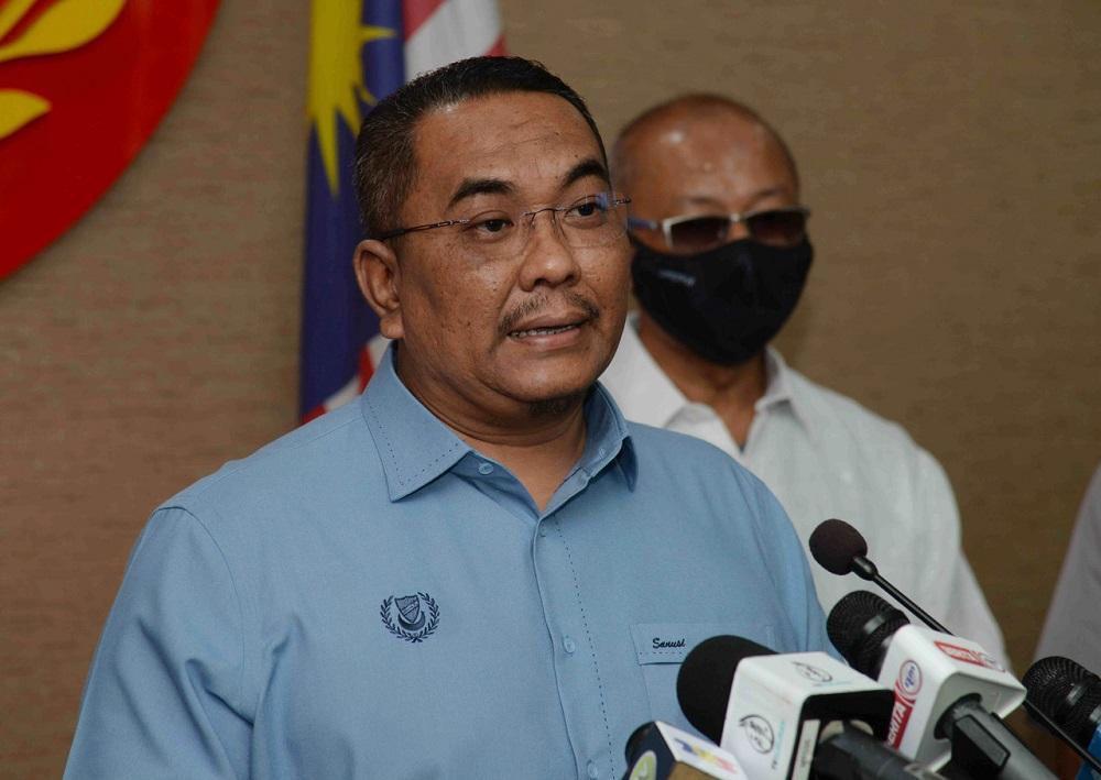 Several individuals including Kedah MB Muhammad Sanusi Nor were allegedly test driving a car at Juru Autocity despite a movement control order in Penang. — Bernama pic