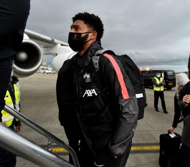 Liverpool defender Joe Gomez looks on before getting on a flight
