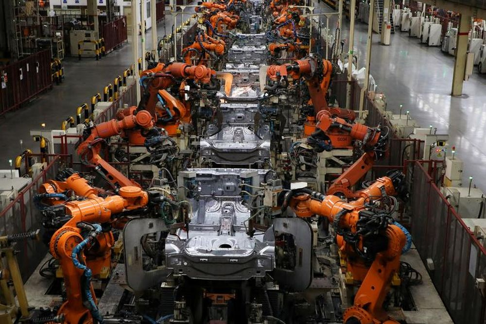 Robots welding body-shells of car are pictured on the assembly line in the Proton manufacturing plant in Tanjung Malim, December 16, 2019. — Reuters pic