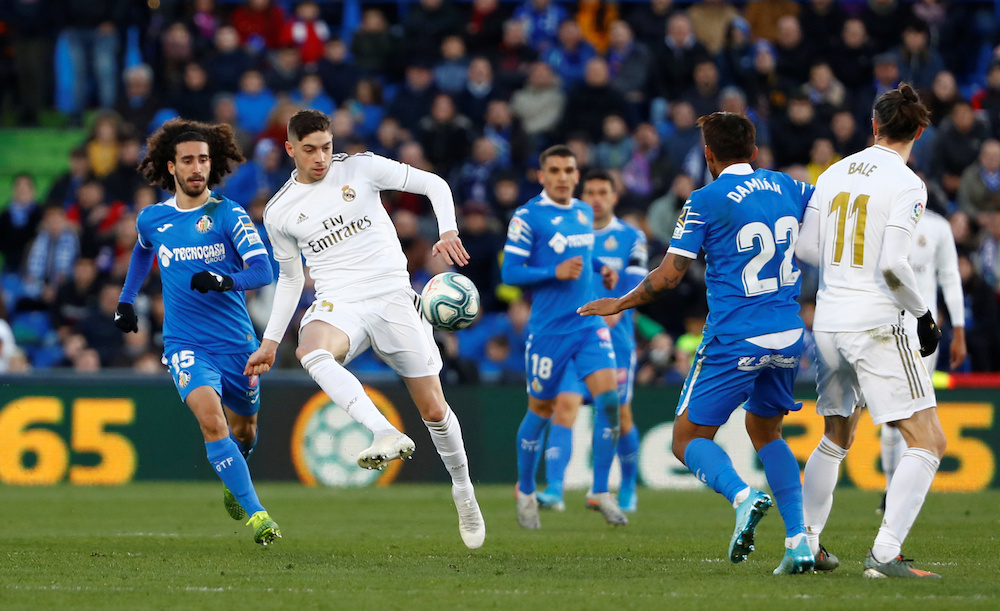 Real Madrid's Federico Valverde in action with Getafe's Marc Cucurella during their La Liga match at Coliseum Alfonso Perez in Getafe January 4, 2020. Real did not say when the Uruguay midfielder could expect to return from the injury, although Spanish media reports said he would be out of action for at least a month. — Reuters pic