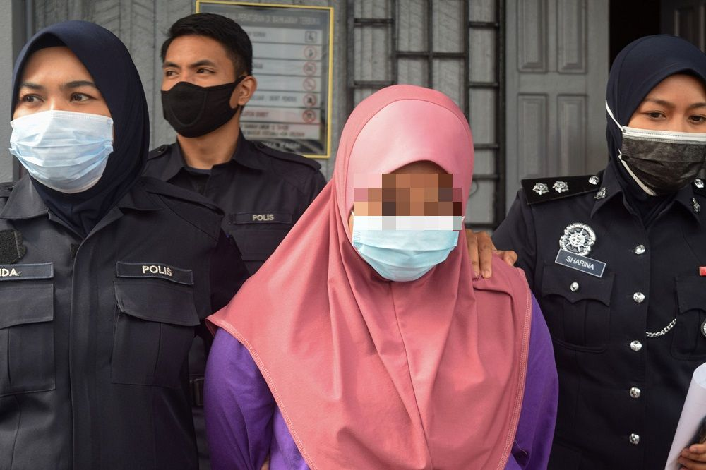 the 19-year-old suspect is led out of the court in Marang November 9, 2020. — Bernama pic