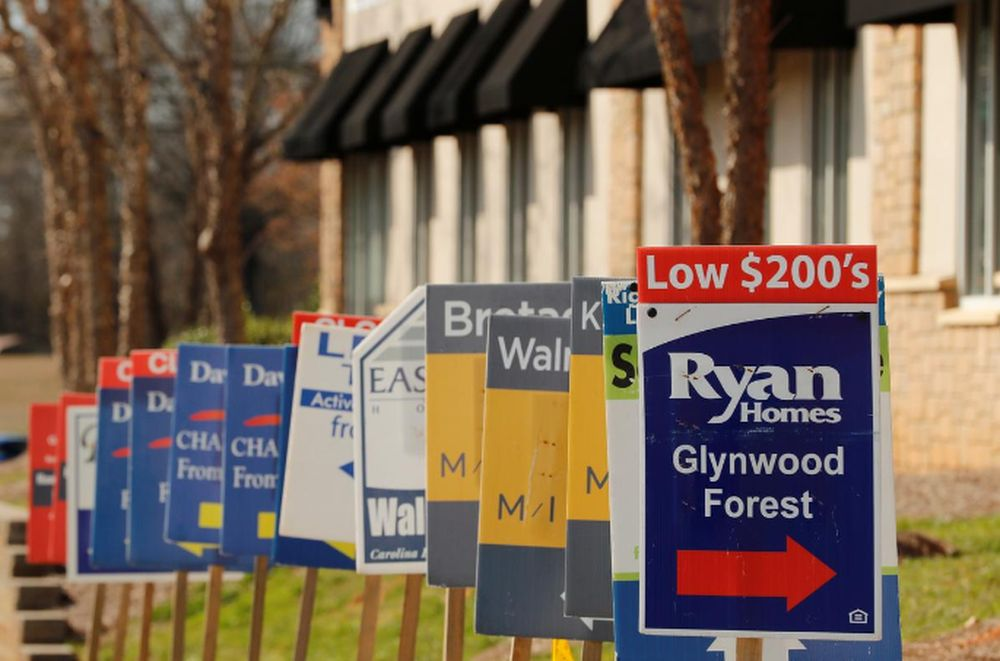 File photo of real estate signs advertising new homes for sale in multiple new developments in York County, South Carolina, US, February 29, 2020. — Reuters pic