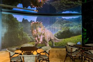 An LED display of a Triceratops. Photo: Jurassic World Cafe