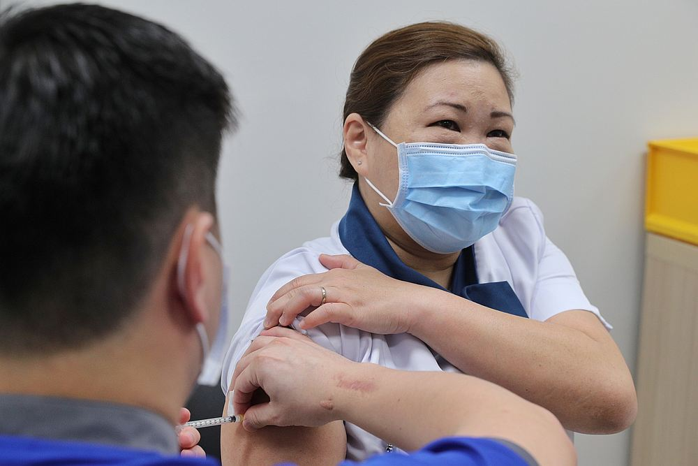 About a third of Malaysians polled said they are either scared or are suspicious of Covid-19 vaccines, according to a Ministry of Health's survey. — Reuters file pic