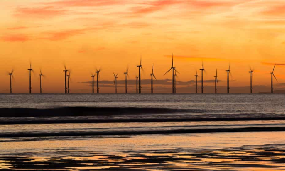 Sunrise from Seaton Carew beach, near Hartlepool, with Teesside offshore windfarm in distance.