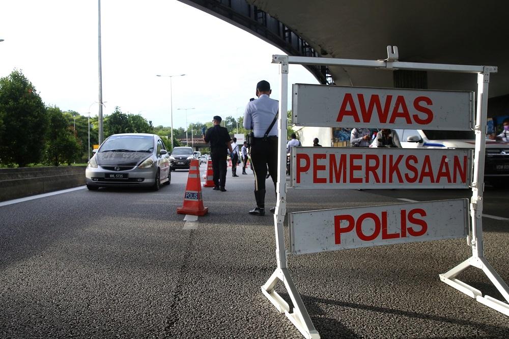 Police man a roadblock along Jalan Syed Putra in Kuala Lumpur January 13, 2021. ― Picture by Choo Choy May