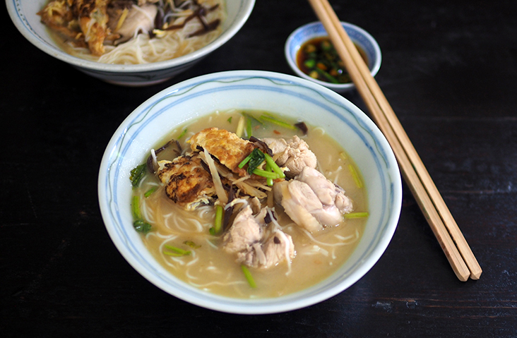 My ultimate bowl of comfort is this flavourful rice wine chicken noodles with chicken, an omelette and lots of ginger cut into strips — Pictures by Lee Khang Yi