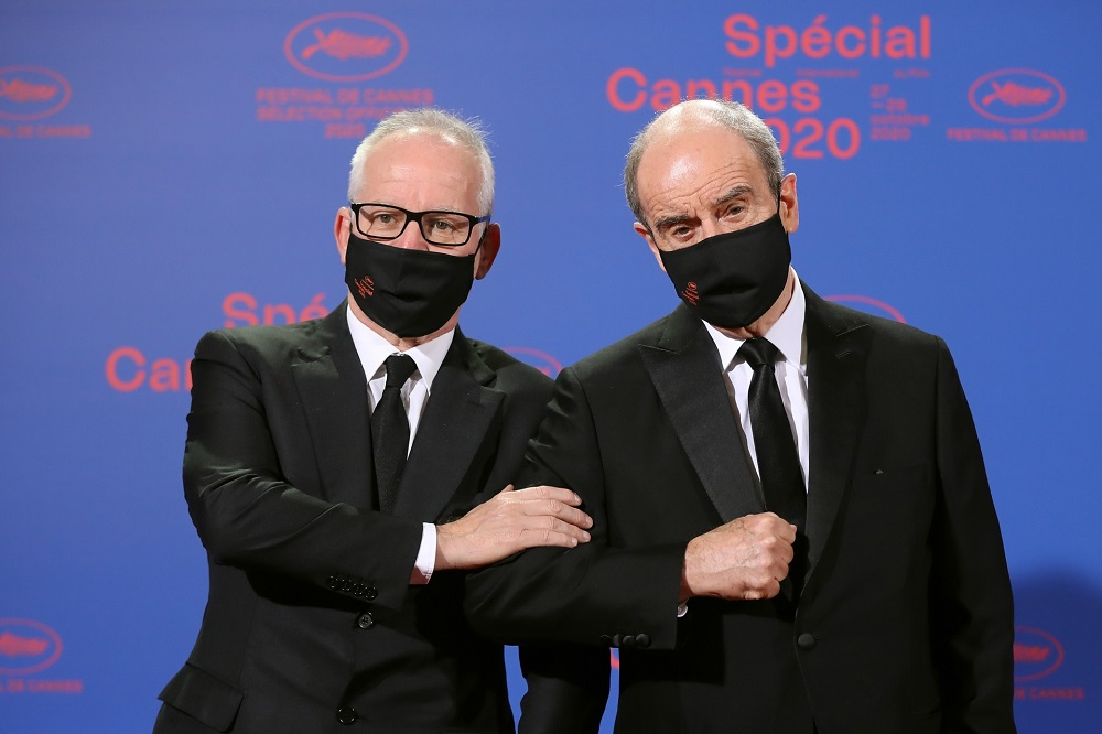 Cannes film festival general delegate Thierry Fremaux (left) and French director of the Cannes film festival Pierre Lescure pose as they arrive at the Palais des Festivals et des Congres ahead of Cannes 2020 Special. — AFP pic