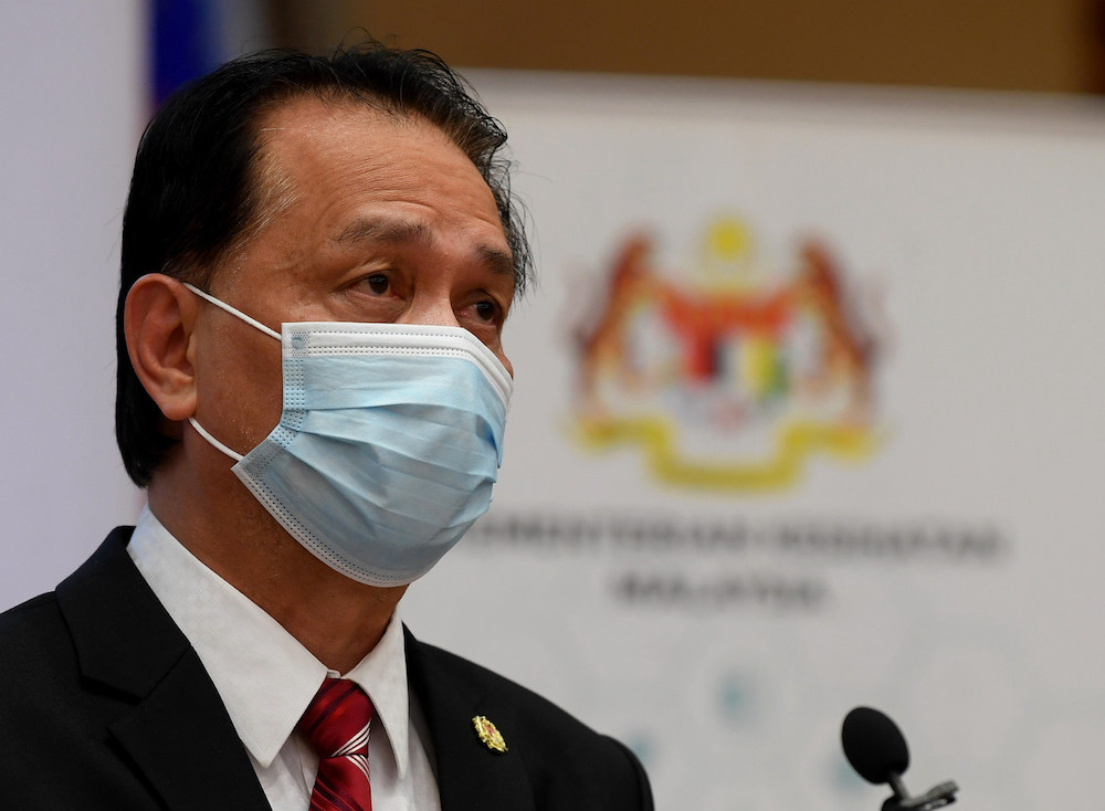Tan Sri Dr Noor Hisham Abdullah says Malaysia's daily Covid-19 cases may return to heights not seen since the peak of the 'third wave' due to non-compliance with preventive SOPs. — Bernama pic
