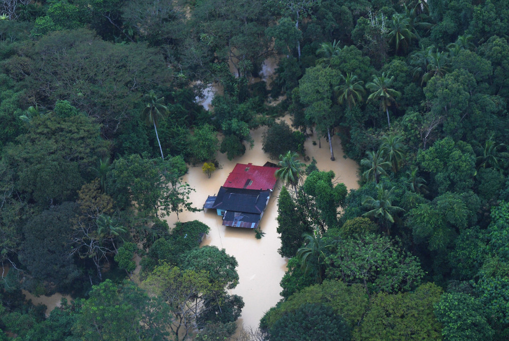 A resident's house is seen flooded after heavy rain fell for more than three days during an air survey with the Fire and Rescue Department of Malaysia (JBPM) in Raub, Pahang, January 4, 2021. — Bernama pic