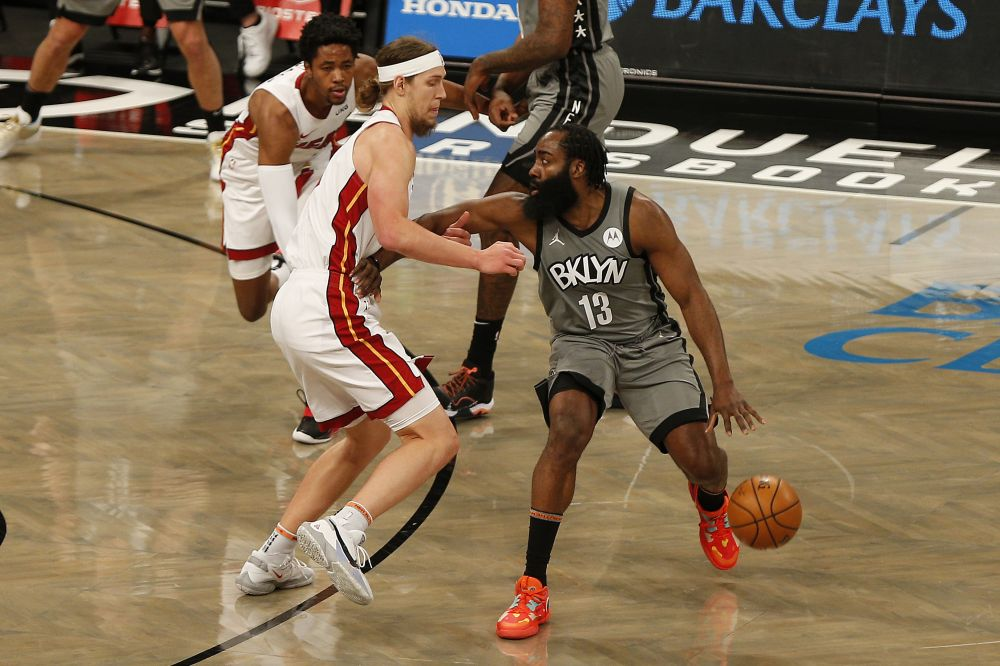 Brooklyn Nets guard James Harden (13) dribbles the ball against Miami Heat forward Kelly Olynyk (9) during the first half at Barclays Centre January 25, 2021. — Reuters pic