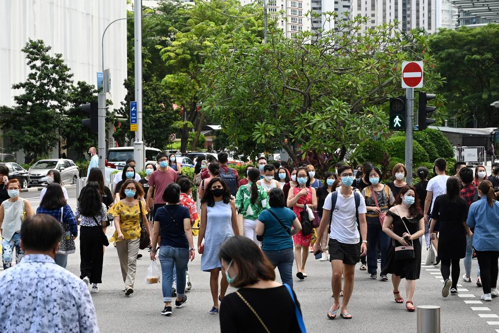 The total number of Covid-19 cases in Singapore now stands at 58,813. ― AFP pic