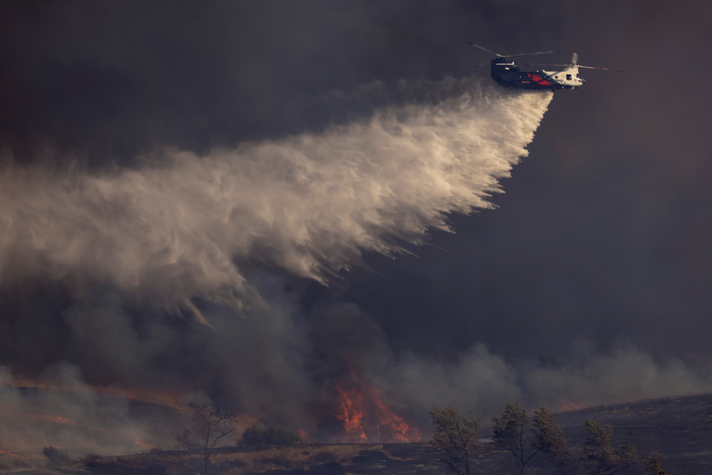 Heat waves and droughts are fuelling wildfires, with US$16 billion in damage last year in the US West. — Reuters pic