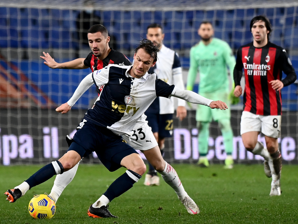 AC Milan midfielder Rade Krunic (left) fights for the ball with Sampdoria midfielder Albin Ekdal during the Italian Serie A football match Sampdoria vs AC Milan at the Luigi Ferrari stadium in Genoa December 6, 2020. — AFP pic