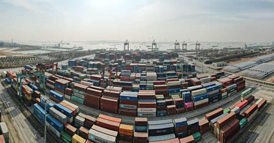 fish eye view of thousands of shipping containers at a chinese port