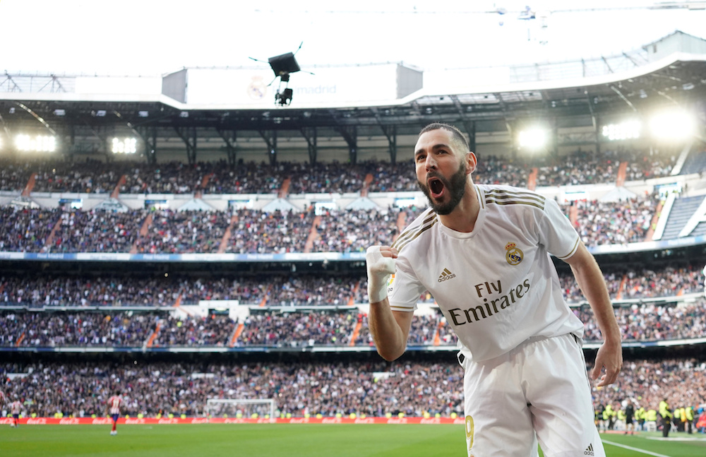 Real Madrid's Karim Benzema celebrates scoring their first goal during the La Liga match with Atletico Madrid at Santiago Bernabeu in Madrid February 1, 2020. — Reuters pic