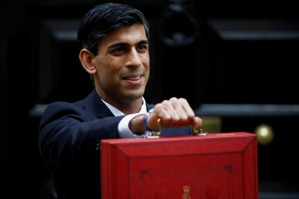 Britain's Chancellor of the Exchequer Rishi Sunak poses with the red budget box outside his office in Downing Street in London March 11, 2020. — Reuters pic