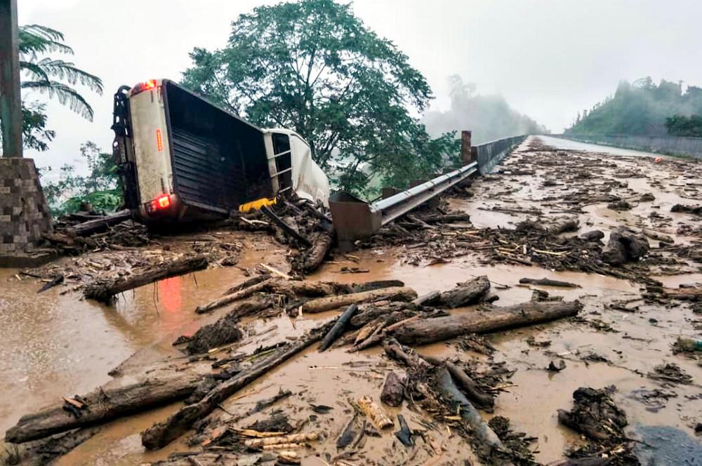 A four-wheel drive vehicle heading from Lojing to Gua Musang overturned when it was carried by mud during heavy rain at Kilometre 92 Jalan Gua Musang-Lojing near Lojing in Kelantan, January 3, 2021. — Bernama pic