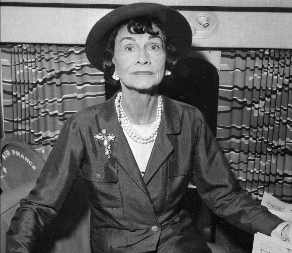 In this file photo taken January 1, 1960, French fashion designer Coco Chanel poses onboard of a plane at Paris airport. — AFP pic