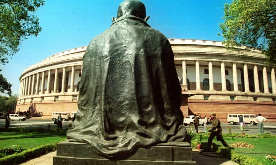 The statue of Mahatma Gandhi surveys the current parliament house.
