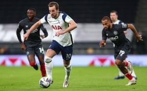 Spurs' Harry Kane surges forward.